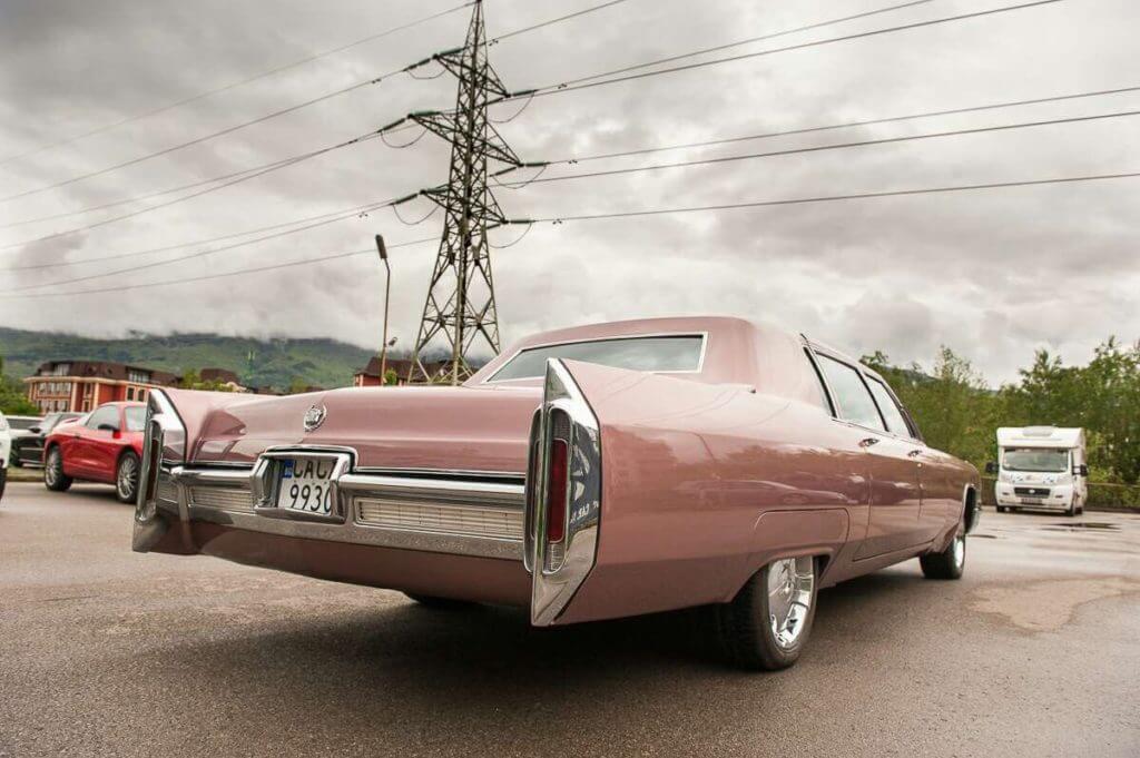 Cadillac fleetwood behind